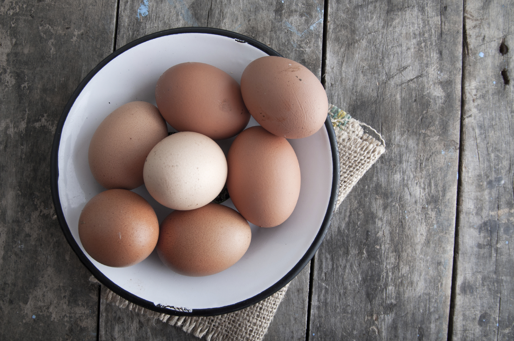 Brown eggs in a white bowl