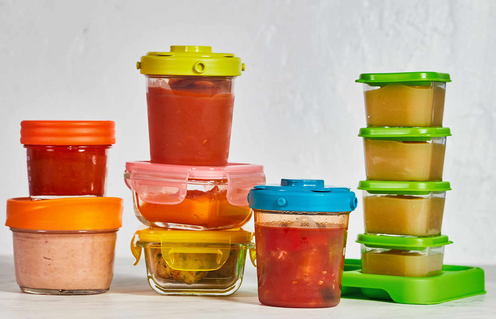 Various baby food purées in small containers